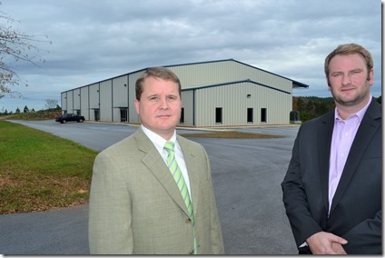 Abbeville County Director David Porter (right) and county Development Services Director Stephen Taylor before the 22,000-square-foot incubator building where Advanced Manufacturing & Power Systems Inc. expects to start operating in January. (Photo by Bill Poovey)
