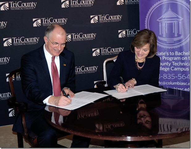 Tri-County Technical College President Ronnie Booth and Columbia College President Elizabeth Dinndorf sign an associate to bachelor's degree program agreement. (Photo provided)
