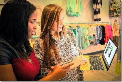 Diana True (right) and business partner Jasmine Ellis check out online fashions at Entourage Clothing & Gifts in Clemson. (Photo provided)