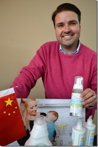 BabyBlossom CEO Matthew Van Patton shows off products that will be sold in China (Photo by Bill Poovey)
