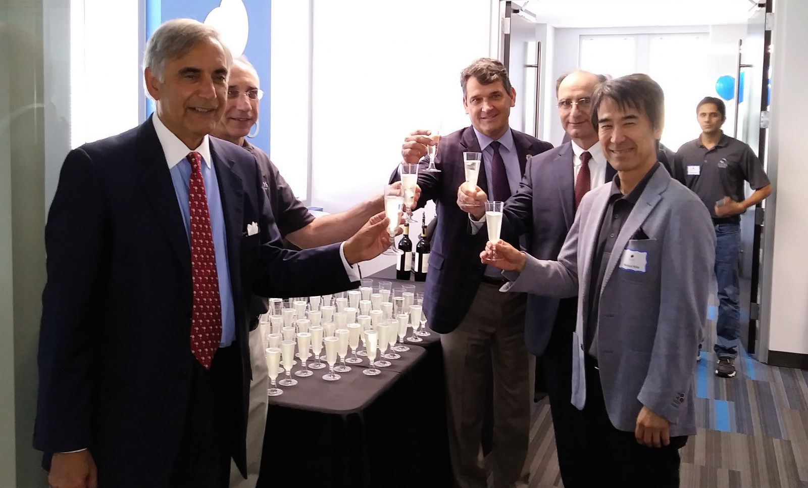 From left: University of South Carolina President Harris Pastides, Jerry Melnick, president and CEO of SIOS Technology, Bill Kirkland, executive director of USC's Office of Economic Engagement, Hossein Haj-Hariri, dean of the College of Engineering and Computing and Nobuo Kita, chairman of Board of Directors for SIOS Technology, share a glass of champagne at the ribbon cutting of SIOS Techonlogy's new research and development center on the campus of USC.