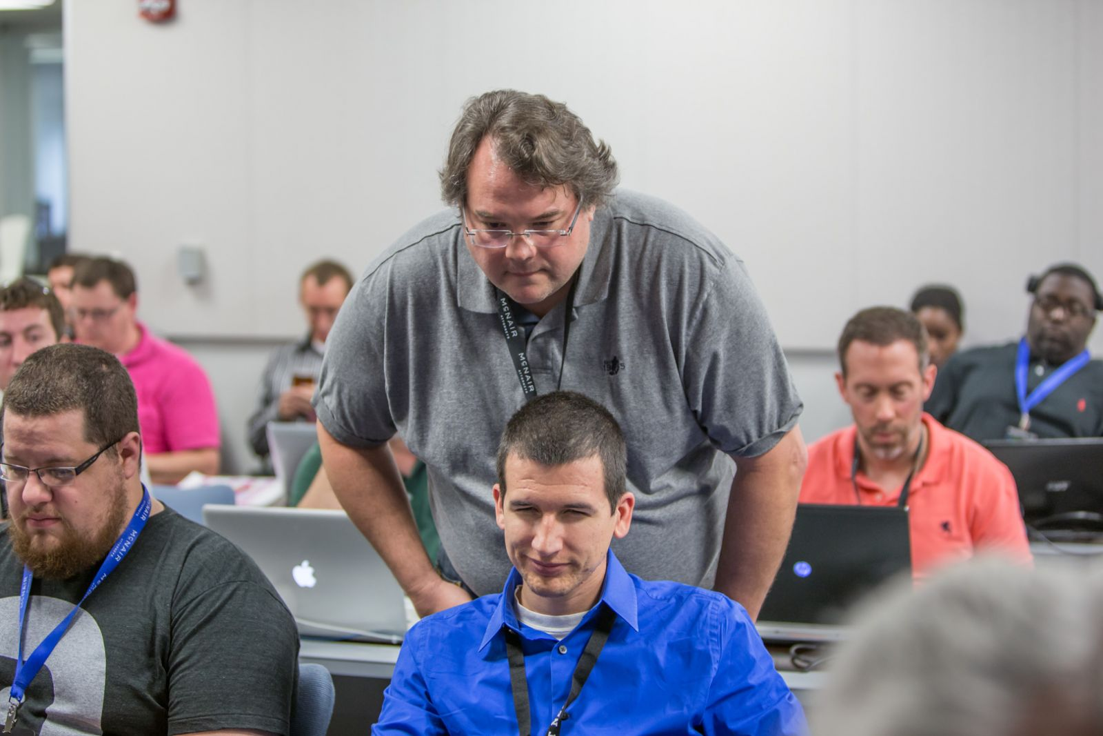 Tom Wilson (standing), the founder of Jack Russell Software, will head up a new innovation center in Mount Pleasant focused on technology and health care. Its first initiative is launching a 12-week coding school this fall. (Photo/Posscon 2015)
