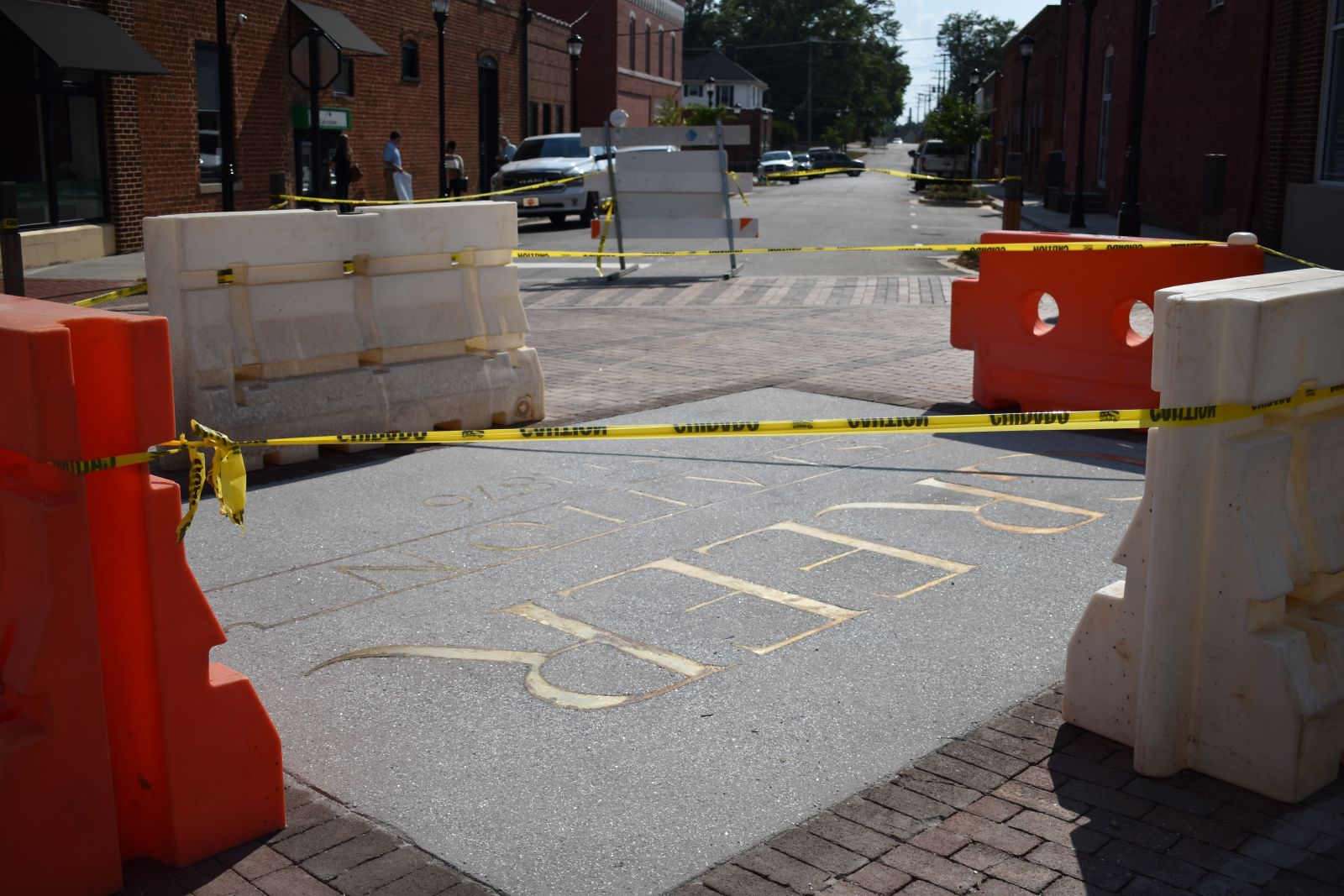 By July 2, the centerpiece inlay at the intersection of Trade and Randall Street had been installed and was blocked off from traffic. (Photo/Molly Hulsey)