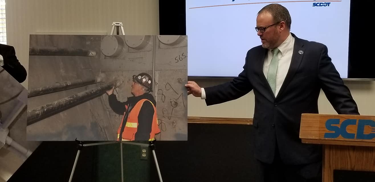 LeLand Colvin, DOT's deputy secretary for engineering, showed photos of engineers inspecting the James B. Edwards Bridge during a news conference on Friday. (Photo/SCDOT)