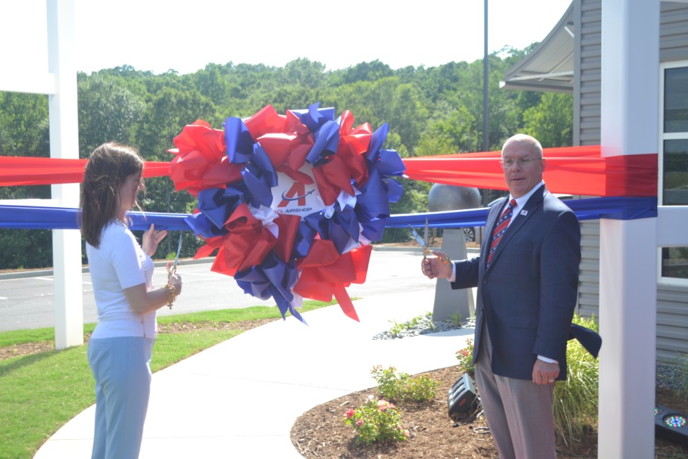 S.C. Lt. Gov. Pamela Evette takes care of ribbon-cutting duties with ACL Airshop CEO Steve Towned. (Photo/Ross Norton)