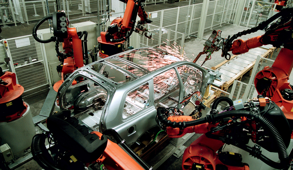 Robots perform welding tasks and put the doors onto cars at a Volvo manufacturing facility in Sweden. The automaker plans to deploy the same automation technology at its new Berkeley County plant. The robots prevent workers from having to handle large welding guns while squeezing into tight spots and twisting their bodies for long periods of time to complete a task. (Photo/Volvo Cars)