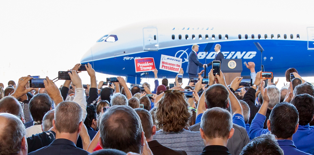 Boeing CEO Dennis Muilenburg welcomes President Donald Trump to the 787-10 rollout event in front of thousands at Boeing S.C. on Friday in North Charleston. (Photo/Kim McManus)