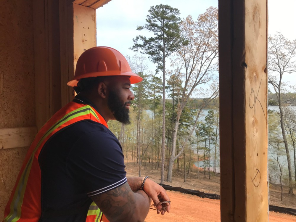 Tajh Boyd often takes interested buyers on tours of the construction site. (Photo/Teresa Cutlip)
