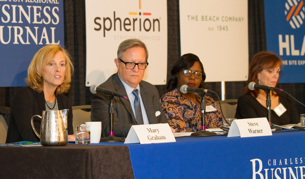 Mary Graham (from left) of the Charleston Metro Chamber of Commerce, Steve Warner of the Charleston Regional Development Alliance, Michelle Mapp of the S.C. Community Loan Fund and Peggy Frazier of Blackbaud speak at the Power Breakfast event. (Photo/Kim McManus)