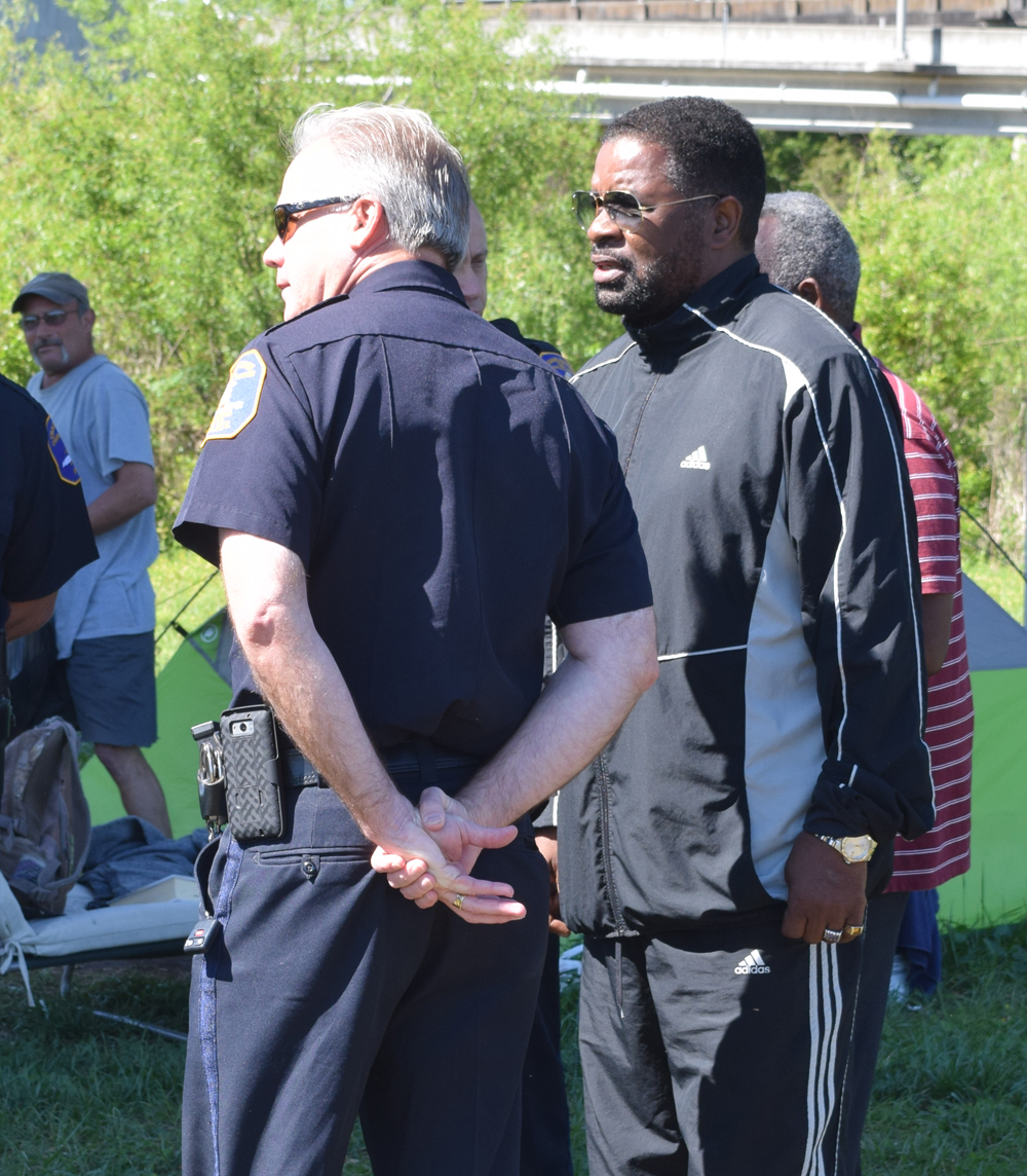 Charleston Police Chief Greg Mullen talks with Rep. Wendell Gilliard, D-Charleston, as people move from Tent City to the transitional housing center in April 2016. (Photo/File)