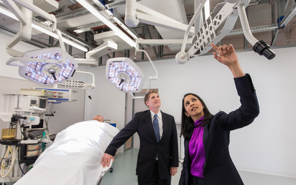 Dr. Scott Reeves (left) and Anjali Joseph examine the operating room prototype. Equipment was provided by medical device companies that have partnered with the project. (Photo/Medical University of South Carolina)