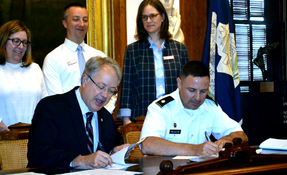 Charleston Mayor John Tecklenburg and Lt. Col. Jeffrey Palazzini, district commander of the Army Corps' Charleston District, signed an agreement today to begin the Charleston peninsula flooding study. They talked about flooding challenges facing the city during a news conference in Charleston City Hall. (Photo/Liz Segrist)