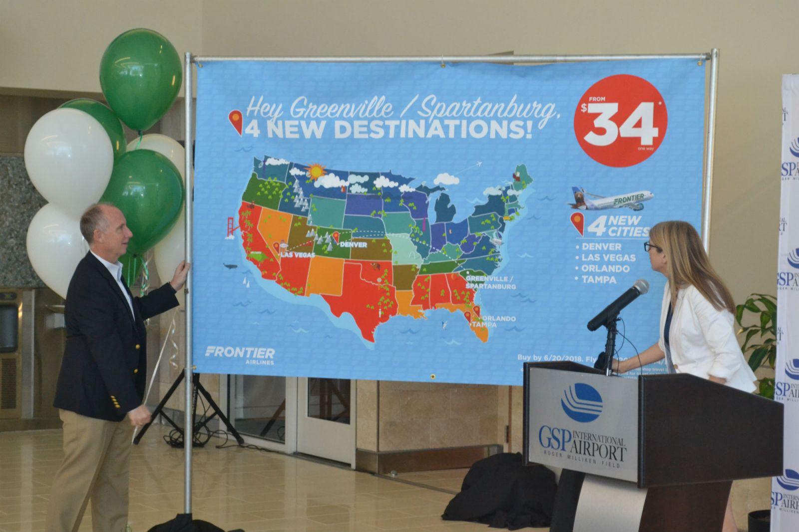 Dave Edwards, president and CEO of GSP, and Tyri Squyres, vice president of marketing for Frontier, announce the new nonstop flights Frontier will offer. (Photo/Ross Norton)