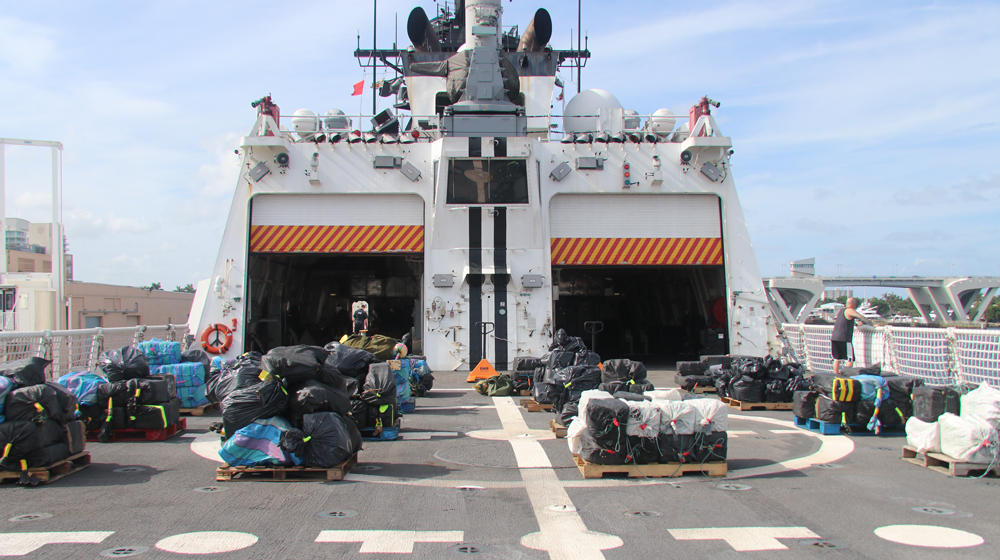 An estimated 12,500 pounds — more than 6 tons — of cocaine and 50 pounds of marijuana lie on pallets onboard the Coast Guard Cutter Hamilton on Wednesday in Port Everglades, Fla. The drugs were seized by the Coast Guard cutters Hamilton, Alert and Venturous off the coasts of Mexico, Central and South America. (Photo/Coast Guard Ensign Kiana Kekoa)