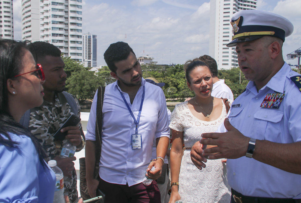 Chief Warrant Officer Miguel Felix (right) explains the Coast Guard cutter Hamilton's capabilities to members of the Colombian media Saturday during Sail Cartagena de Indias 2018 in Cartagena, Colombia. (Photo/Coast Guard Ensign Kiana Kekoa)