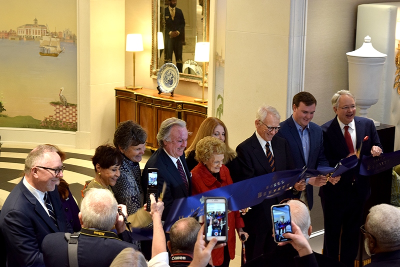 Michael Bennett (fourth from left) and his mother Virginia Bennett (fifth from left) cut the ceremonial ribbon at Hotel Bennett on Friday alongside hotel leadership, former Charleston Mayor Joe Riley and Mayor John Tecklenburg. (Photo/Patrick Hoff)