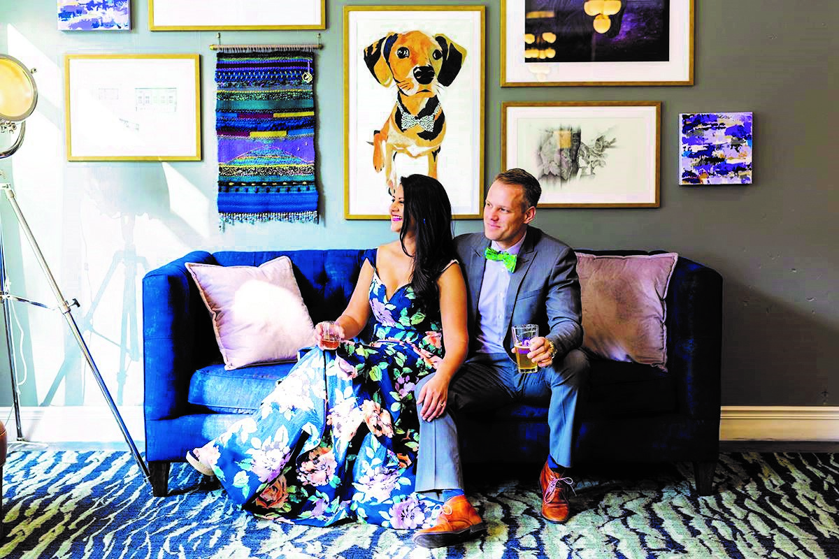 Hotel Trundle co-owners Rita Patel and Marcus Munse pose after learning their downtown boutique hotel was named to Southern Living magazine's Hotel Collection last October. (Photo/Provided)