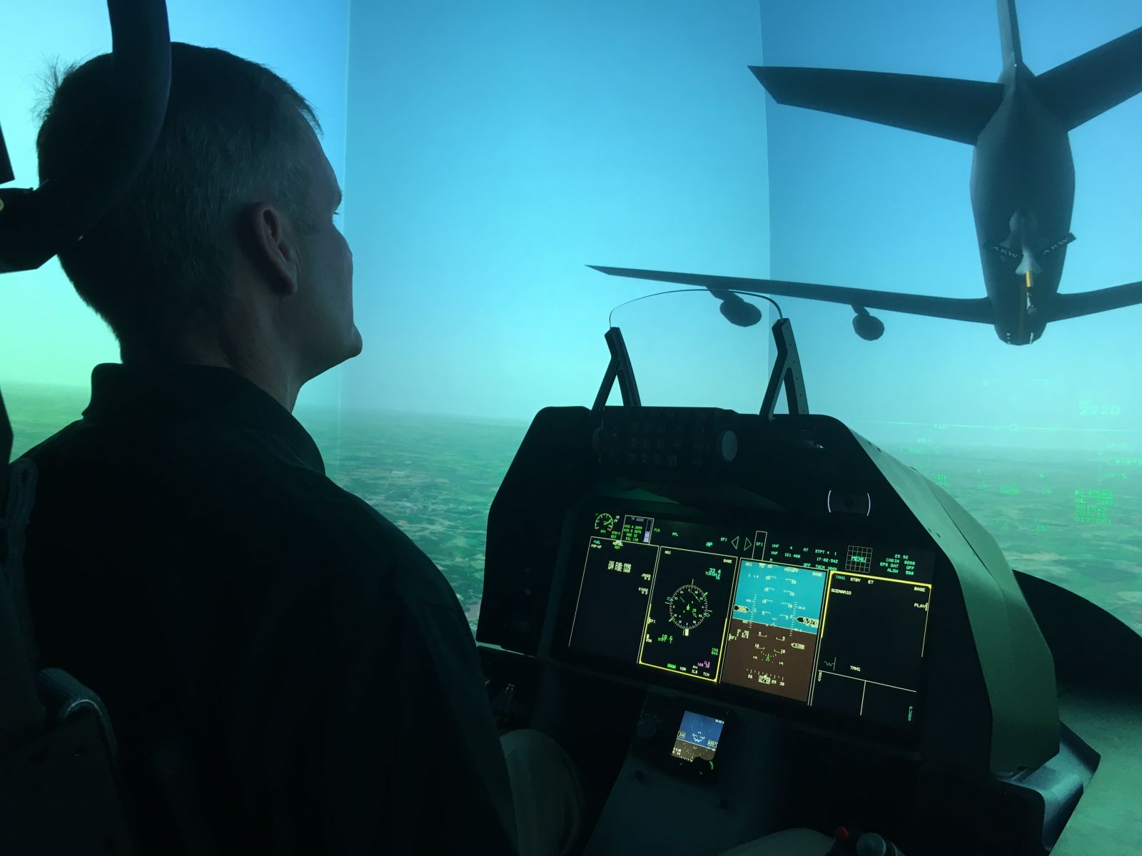 A Lockheed Martin employee shows off the flight simulator which is a part of the ground-based training system for the T-50A. Officials said if the company is awarded the nearly $10 billion contract, Air Force trainers could be trained at the company's Greenville facility. (Photo/Matthew Clark)
