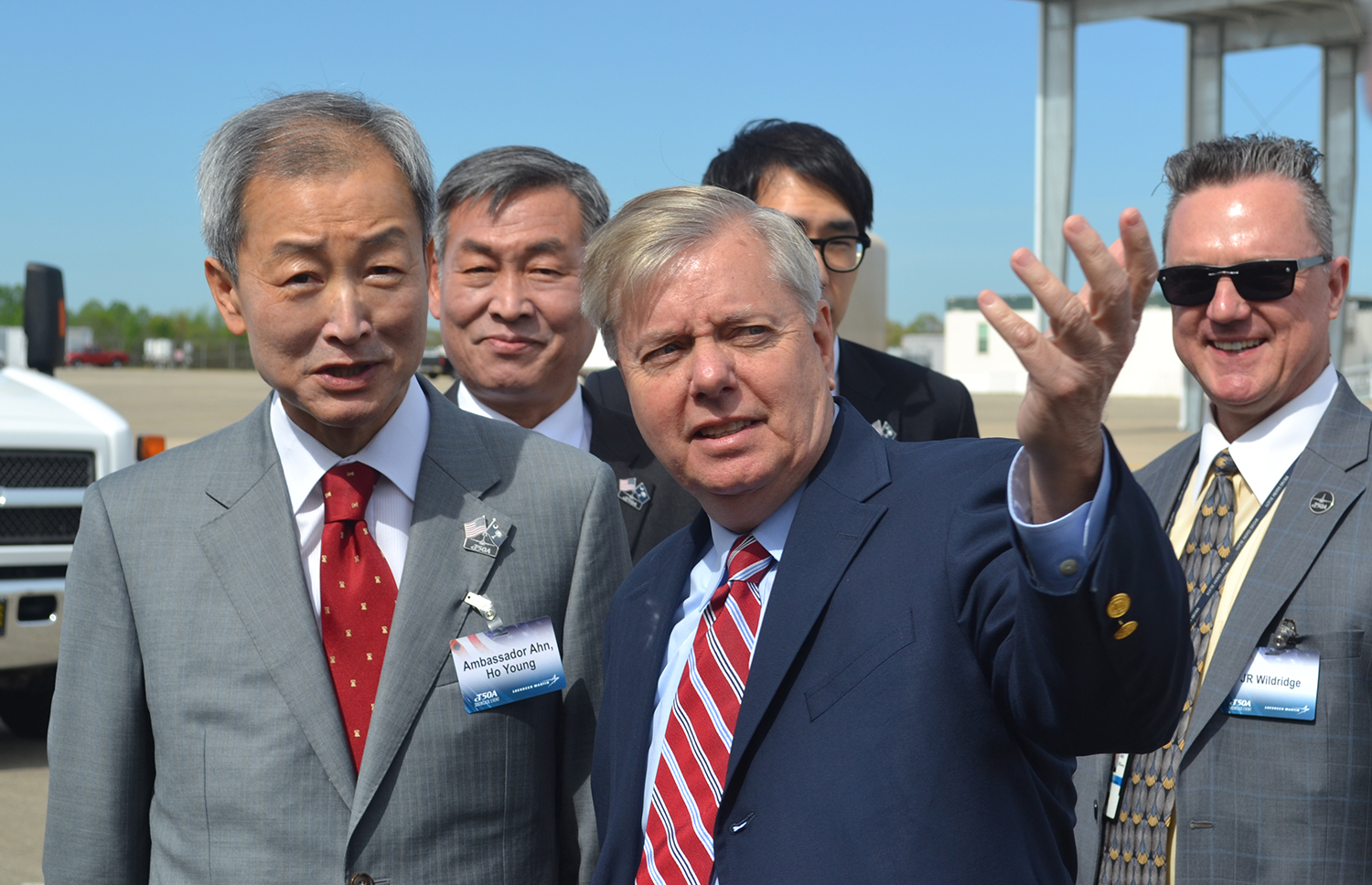 Sen. Lindsey Graham, R-S.C., discusses the T-50A fighter/trainer aircraft with An Ho-young, South Korea ambassador to the United States during the T-50A showcase event at the Lockheed Martin Greenville Operations site on Monday, April 10, 2017 (Photo/Matthew Clark)