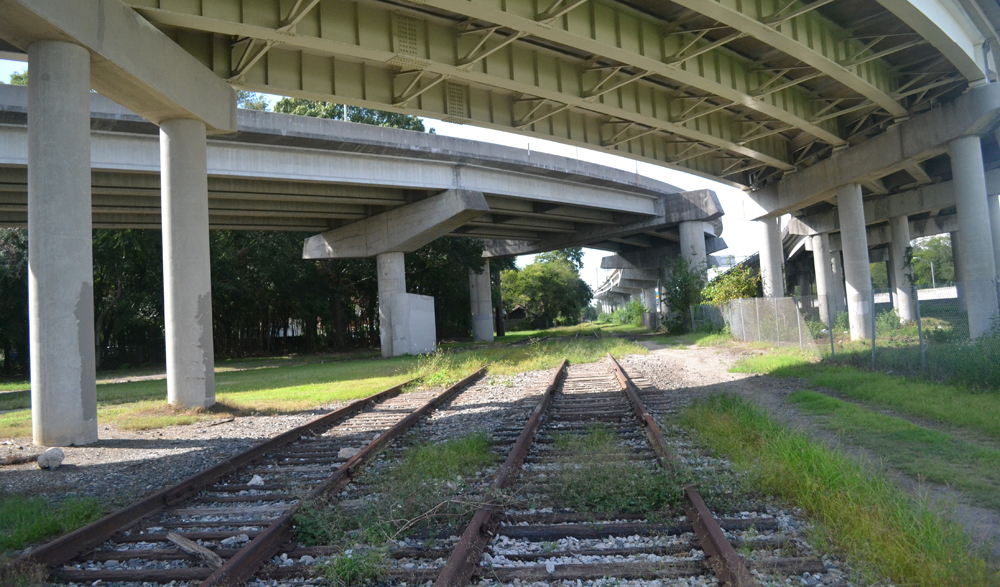 Planners and city officials anticipate turning the old train tracks that run below Interstate 26 into a paved trail and linear park, reconnecting neighborhoods in downtown Charleston. (Photo/Liz Segrist)