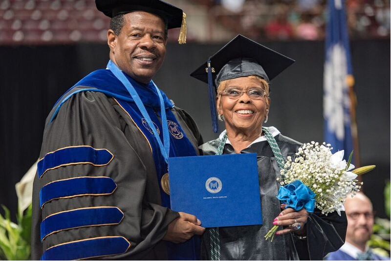 Annie Dillard, 92, pictured with Midlands Tech president Ronald Rhames, received an Associate of Arts degree at age 92. (Photo/Provided)