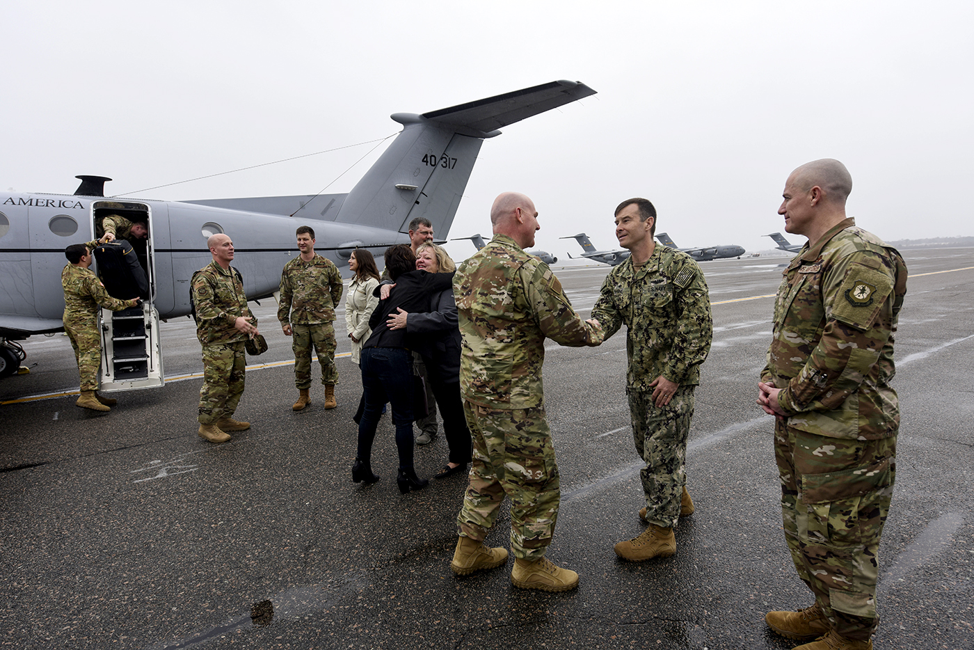 Maj. Gen. Sam Barrett greets Joint Base Charleston leadership. The 18th Air Force, headquartered at Scott Air Force Base, Ill., oversees the base's 437th Airlift Wing. (Photo/Airman 1st Class Allison Payne for the Air Force)