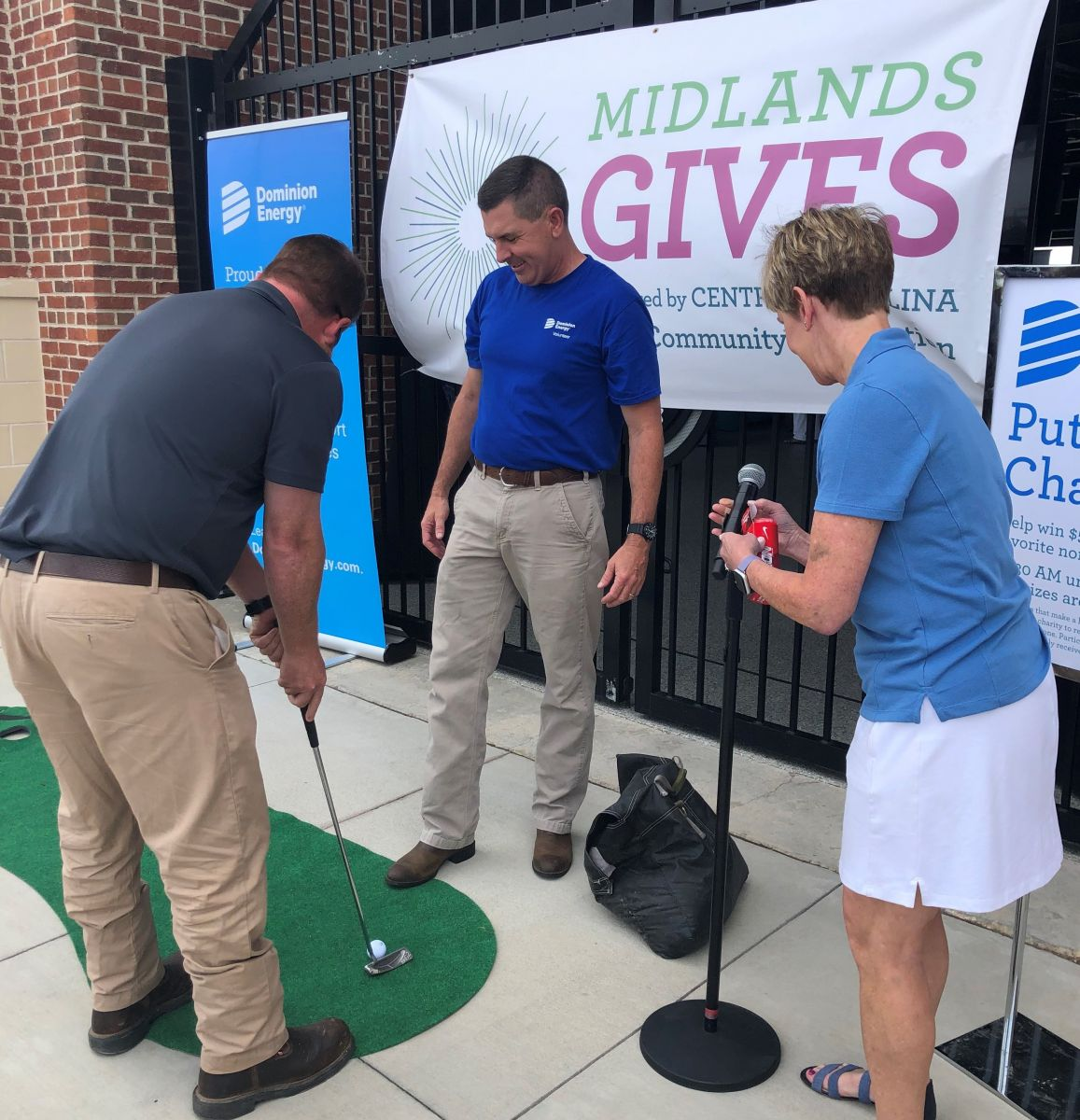 Participants test their skills in the Dominion Energy putting challenge during the 2019 Midlands Gives event at Segra Park. (Photo/Provided)