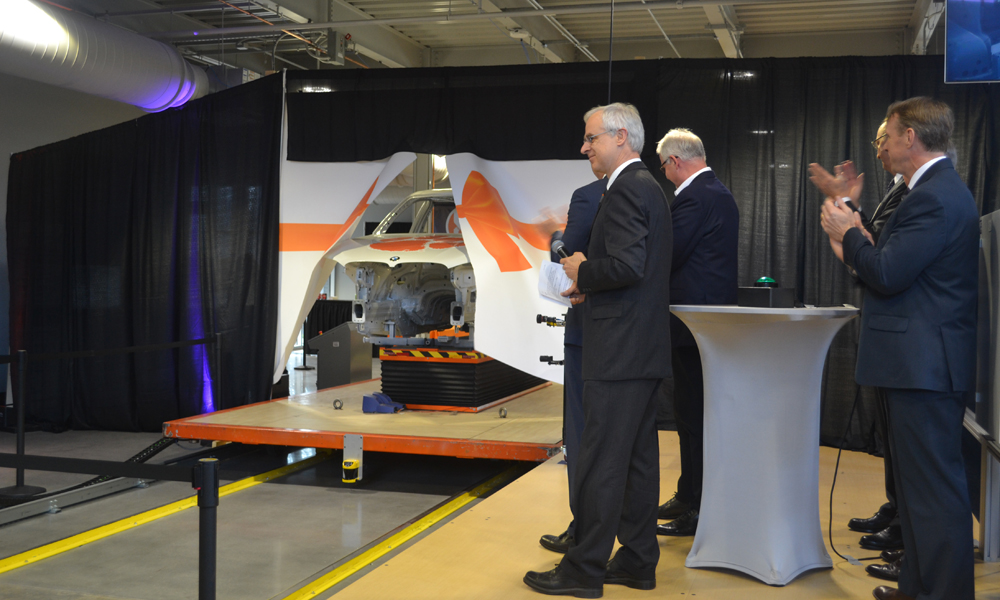 "Officials representing Clemson University, Greenville Technical College, BMW Manufacturing and Siemens officially open the Vehicle Assembly Center by ""crashing"" a ribbon with a vehicle moving along a prototype assembly line. (Photo/Ross Norton)"