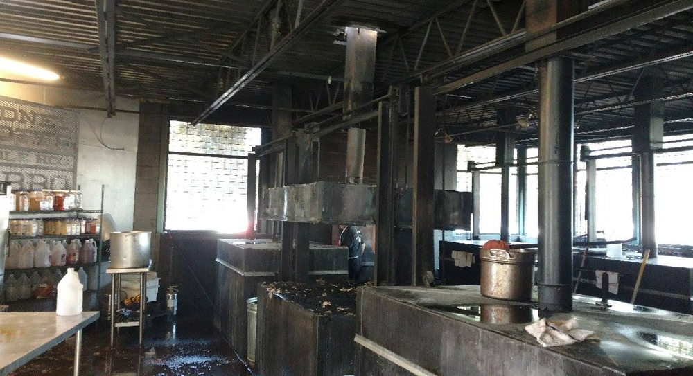 Damage from Sunday's fire at Rodney Scott's BBQ was mostly contained to a single smoker and some surrounding electrical circuits. (Photo/Charleston Fire Department)