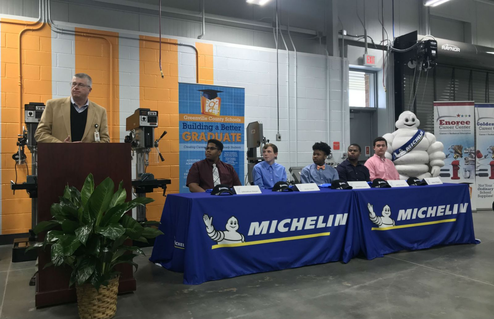 Michelin North America and Greenville County schools partnered for the Michelin Youth Apprenticeship program and held a signing day for the first five apprentices. From left, Burke Royster, superintendent of Greenville County schools, and apprentices Johnathan Harper, Jacob Tucker, Iquavious Lewis, Janias Tinch and Aidan O'Boyle. (Photo/Teresa Cutlip)