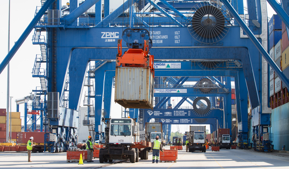 Cargo containers are unloaded from and loaded onto containerships at the Wando Welch Terminal in Mount Pleasant. (Photo/Kim McManus)