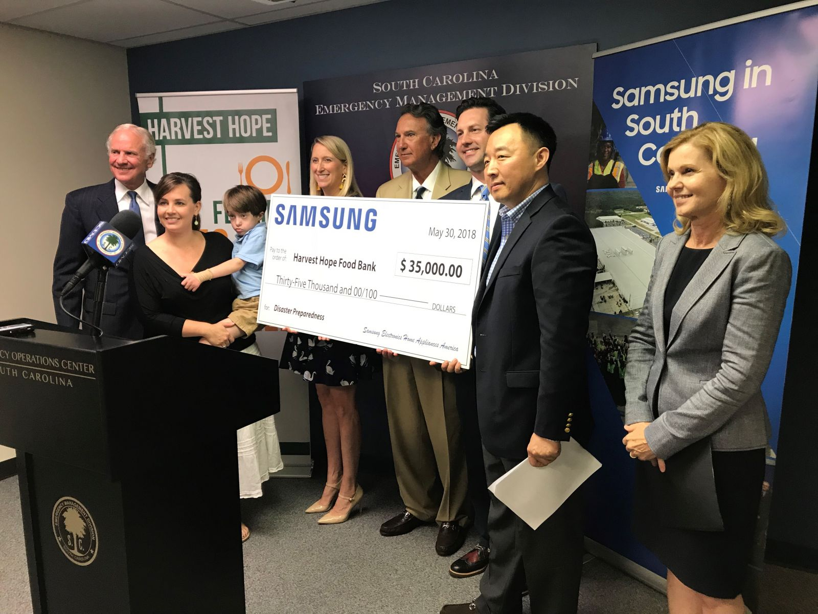 Left to right: Gov. Henry McMaster joins Samsung, Harvest Hope and DHEC officials at the presentation of Samsung's $35,000 donation to Harvest Hope. (Photo/Provided)