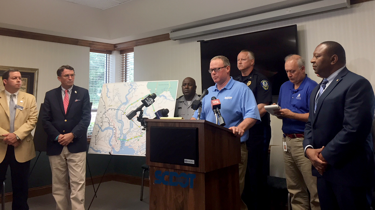 Local and state government and law enforcement officials talk about the status of the Interstate 526 bridge over the Wando River today. (Photo/Liz Segrist)