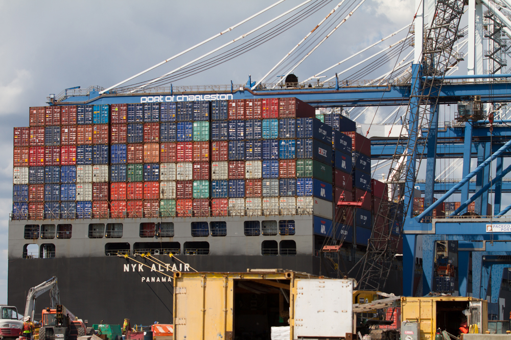 A crane loads containers onto a ship at the Wando Welch Terminal in Mount Pleasant. (Photo/Kim McManus)