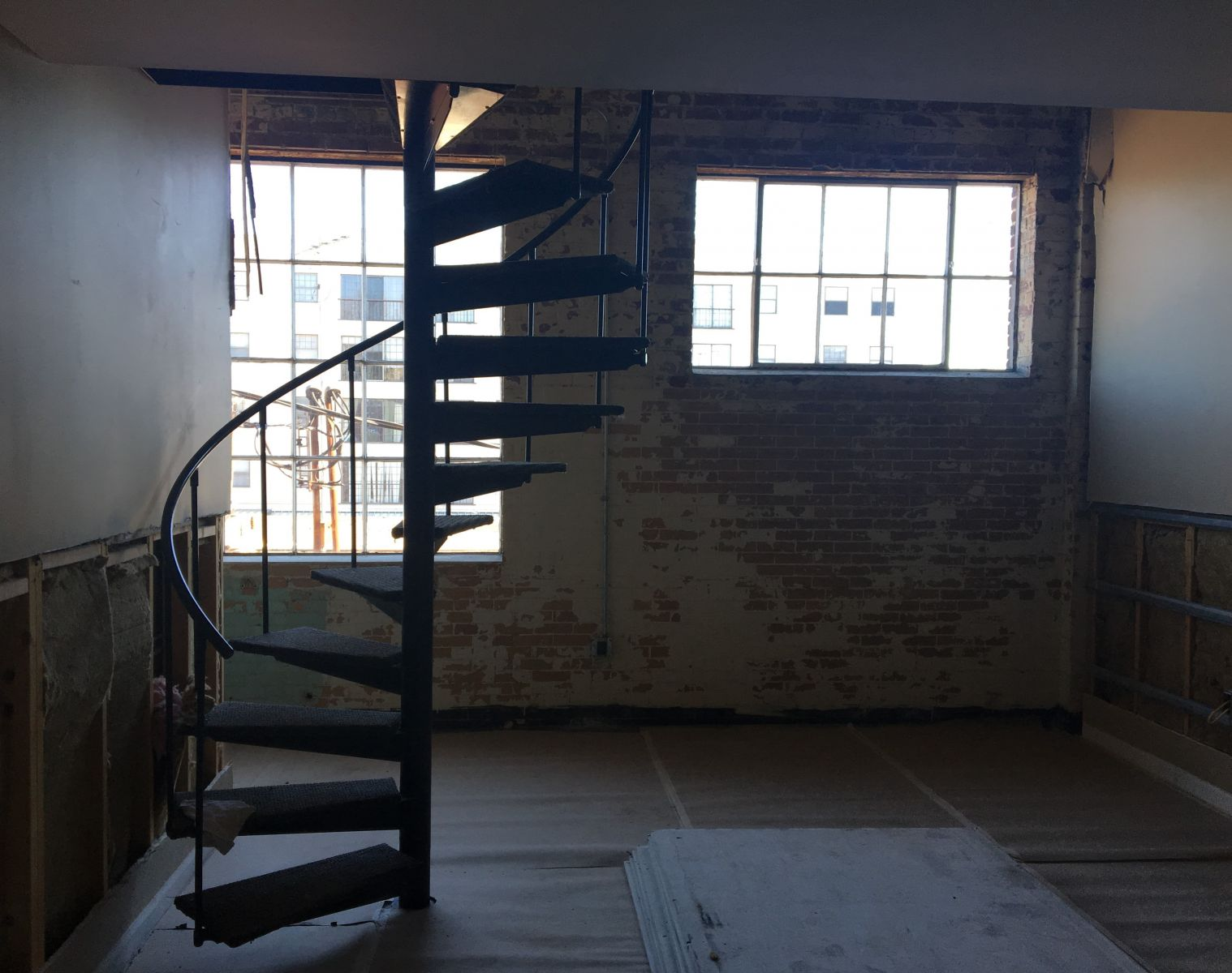 Eight upstairs lofts feature spiral staircases leading to a bedroom. All units are being outfitted with kitchenettes. (Photo/Melinda Waldrop)