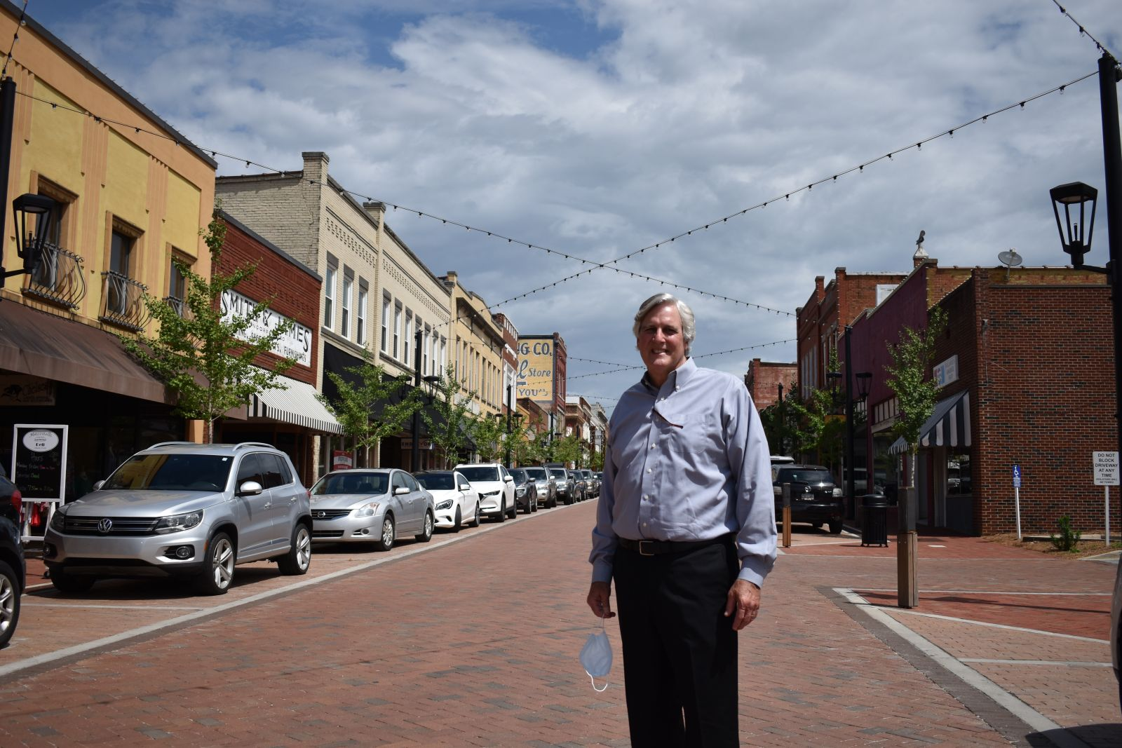 Mayor  Rick Danner stands in front of CenterG's Trade Street improvements. (Photo/Molly Hulsey)