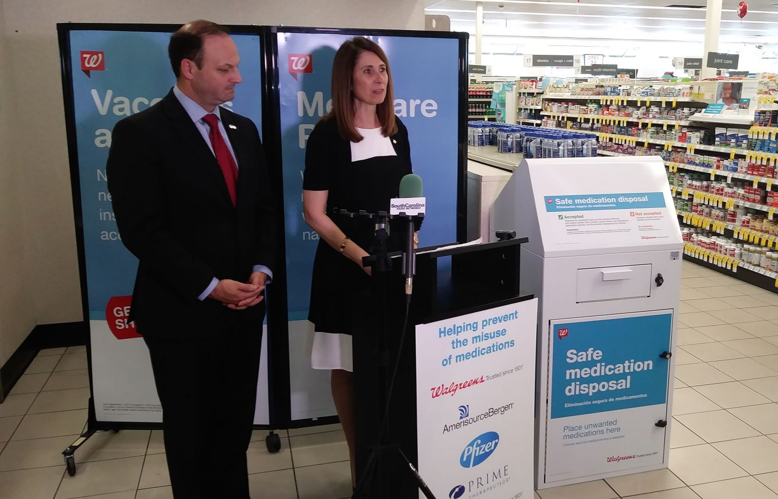 Niki Pappos-Elledge (right), health care supervisor for Columbia Walgreens, announces the addition of 11 medication disposal kiosks around the state. She is joined by S.C. Attorney General Alan Wilson. (Photo/Travis Boland)