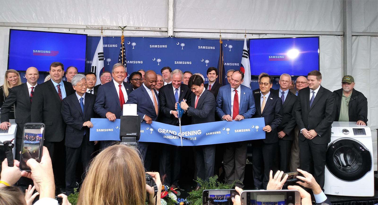State leaders including Gov. Henry McMaster (center) and U.S. Sen. Tim Scott (left of McMaster) celebrated the grand opening of Samsung's Newberry manufacturing plant on Friday. (Photo/Travis Boland)