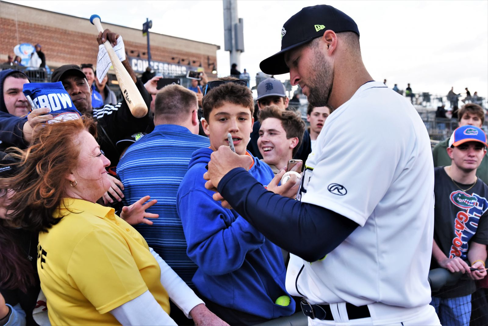 Tim Tebow (right) has become an instant hit with Fireflies' fans as he charts a new career in professional baseball. At the team's April 6 opener, Tebow appeared in midseason form signing autographs on baseballs, bats and T-shirts. (Photo/Chuck Crumbo)(