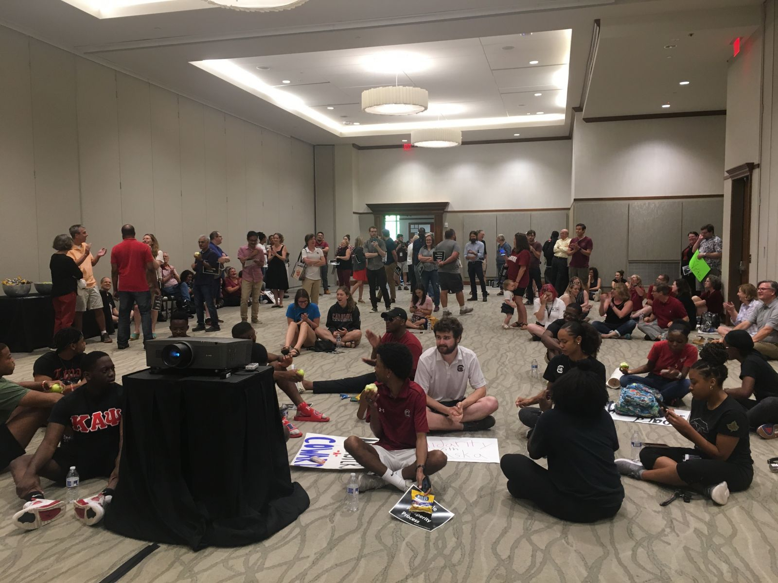 Protesters gather at the Pastides Alumni Center in advance of a contentious University of South Carolina board of trustees vote to elect Robert Caslen the school's new president. (Photo/Renee Sexton)